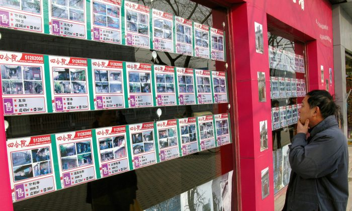 A man looks at a board displaying real estate listings in Beijing, on Dec. 18, 2007. (Teh Eng Koon/AFP/Getty Images)