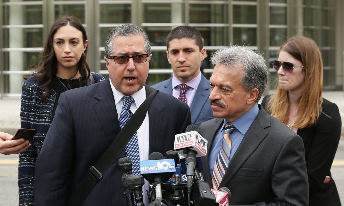 Legal Council representing Keith Raniere and the group NXIVM Mark Agnifilo and Paul DerOhannesian speak to the media outside the United States Eastern District Court after a bail hearing for actress Allison Mack and NXIVM founder Keith Raniere in relation to the sex trafficking charges in the Brooklyn borough of New York City on May 4, 2018. (Jemal Countess/Getty Images)