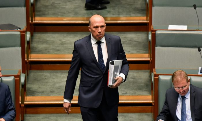 Peter Dutton, Minister for Home Affairs and Minister for Immigration and Border Protection enters the House of Representatives before Question Time on Feb. 5, 2018 in Canberra, Australia. (Michael Masters/Getty Images)