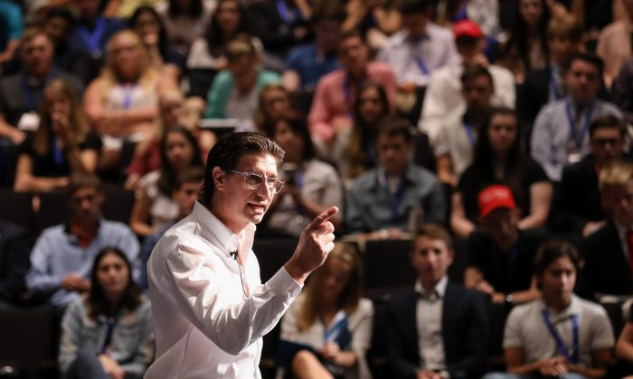 Producer and director Jaco Booyens speaks at the High School Leadership Summit, a Turning Point USA event, at George Washington University in Washington on July 26, 2018. (Samira Bouaou/The Epoch Times)
