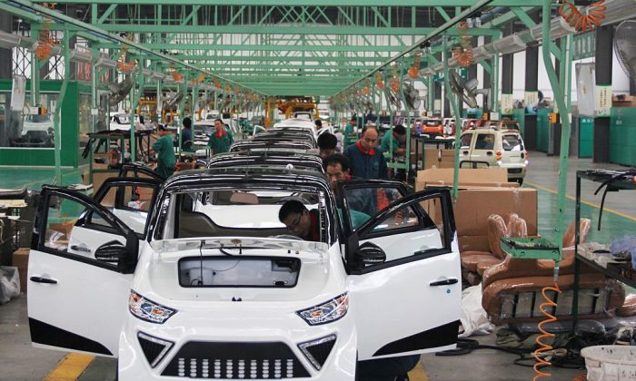 Workers assemble electric cars in a factory in Zouping, east China's Shandong Province on September 16, 2014. (AFP/AFP/Getty Images)
