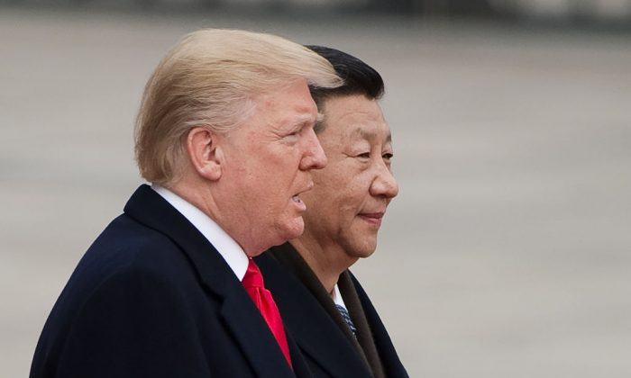 U.S. President Donald Trump and Chinese leader Xi Jinping attend a welcome ceremony at the Great Hall of the People in Beijing on Nov. 9, 2017. (Nicolas Asfouri/AFP/Getty Images)