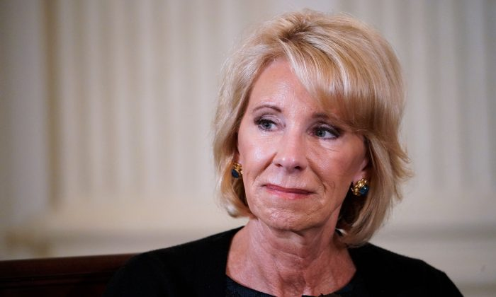 US Education Secretary Betsy DeVos takes part in a listening session on gun violence with teachers and students in the State Dining Room of the White House on February 21, 2018. (MANDEL NGAN/AFP/Getty Images)