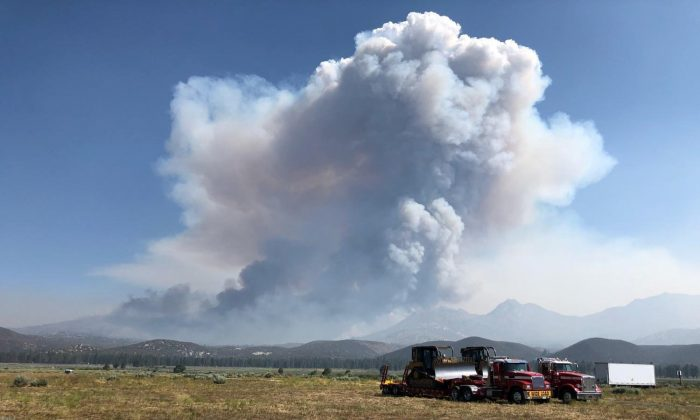 Smoke from the Cranston Fire is shown from east of Lake Hemet in Riverside County, California, U.S., July 26, 2018.  (USFS/Handout via Reuters)