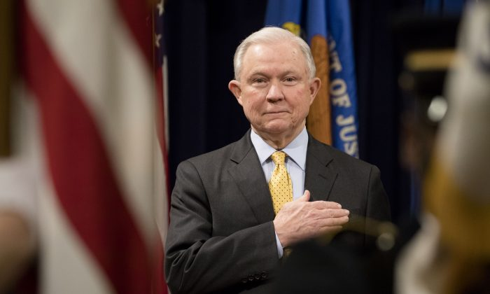 Attorney General Jeff Sessions stands for the national anthem at the Department of Justice Human Trafficking Summit in Washington on Feb. 2, 2018. (Samira Bouaou/The Epoch Times)