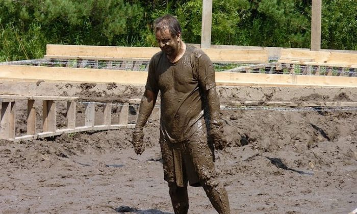 The author, Joe Recupero, as he competed in the Tough Mudder race in 2014. (Alison Webb, Author provided)