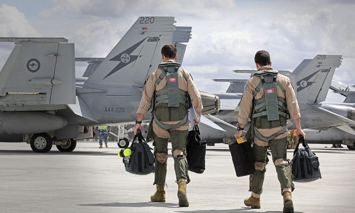 File photo of F/A-18F Super Hornet aircrew members heading to their aircraft in preparation for departure to the Middle East from RAAF Base Amberley on September 21, 2014 in Amberley, Australia. (Photo by CPL Ben Dempster/Royal Australian Air Force via Getty Images)