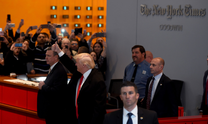 FILE PHOTO: President-elect  Donald Trump  waves to the crowd after leaving a meeting at the New York Times on November 22, 2016 in New York. (Timothy Clary/AFP/Getty Images)