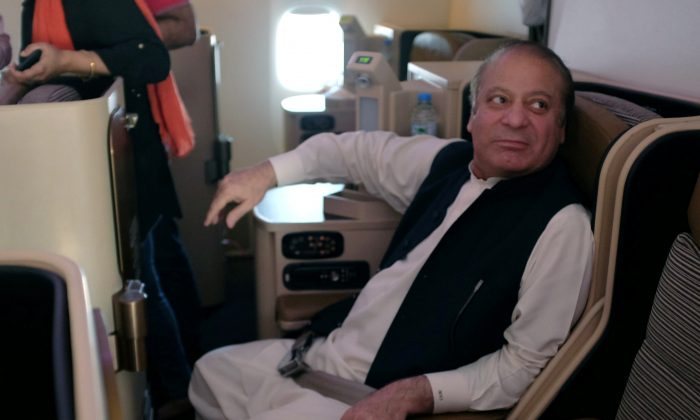 Ousted Pakistani Prime Minister Nawaz Sharif sits on a plane after landing at the Allama Iqbal International Airport in Lahore, Pakistan, July 13, 2018. (Reuters/ Drazen Jorgic)
