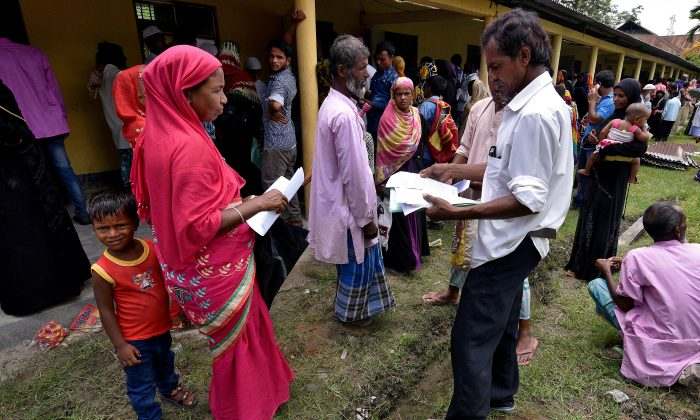 Villagers wait outside the National Register of Citizens (NRC) centre to get their documents verified by government officials, at Mayong Village in Morigaon district, in the northeastern state of Assam, India July 8, 2018. (Reuters/Stringer)