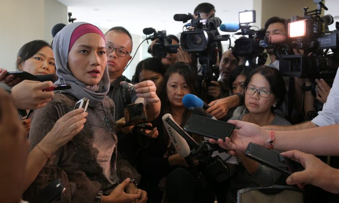 A family member speaks to the media after an MH370 briefing closed door meeting in Putrajaya, Malaysia July 30, 2018.  (Reuters/Sadiq Asyraf)