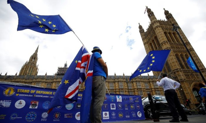Anti-Brexit demonstrators wave EU and Union flags opposite the Houses of Parliament, in London, Britain, June 19, 2018. (Reuters/Henry Nicholls/File Photo)