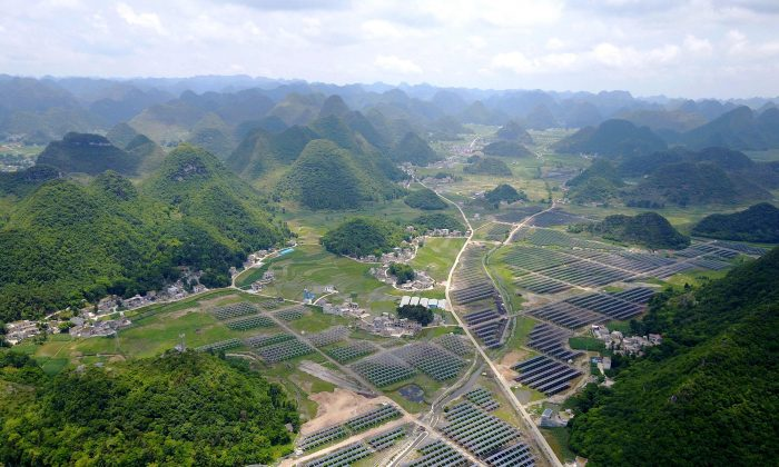 Greenhouses built with solar panels on their roofs in Yang Fang Village in Anlong County, Guizhou Province, on June 10, 2017. (STR/AFP/Getty Images)