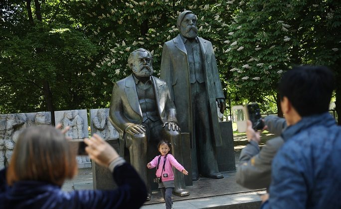 Visitors from China photograph one another in front of a statue of philosopher and revolutionary Karl Marx on May 4, 2018 in Berlin, Germany. Marx's 200th birthday was May 5, 2018. (Sean Gallup/Getty Images)