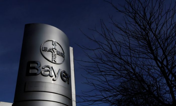 The logo of Bayer AG is pictured at the Bayer Healthcare subgroup production plant in Wuppertal, Germany February 24, 2014. Ina Fassbender/Reuters