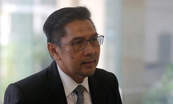 Director General of Civil Aviation Malaysia, Azharuddin Abdul Rahman, arrives for an MH370 meeting in Putrajaya, Malaysia July 30, 2018.  (REUTERS/Sadiq Asyraf)