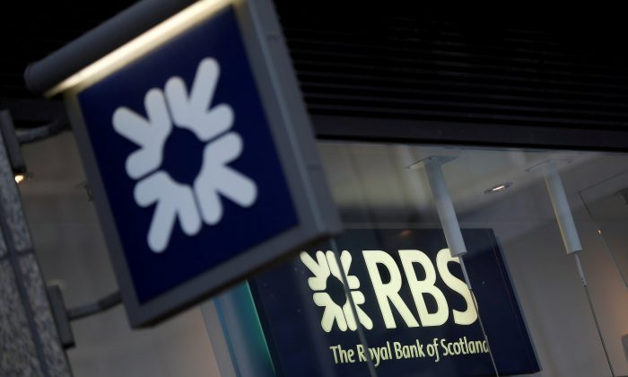 Royal Bank of Scotland signs are seen at a branch of the bank, in London, Britain December 1, 2017.  (Reuters/Peter Nicholls/File Photo)