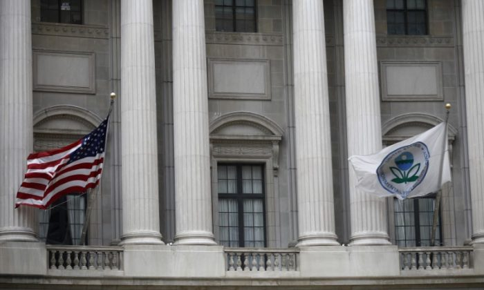 Flags fly outside the U.S. Environmental Protection Agency (EPA) at EPA headquarters in Washington, on July 11, 2018. (Reuters/Ting Shen)