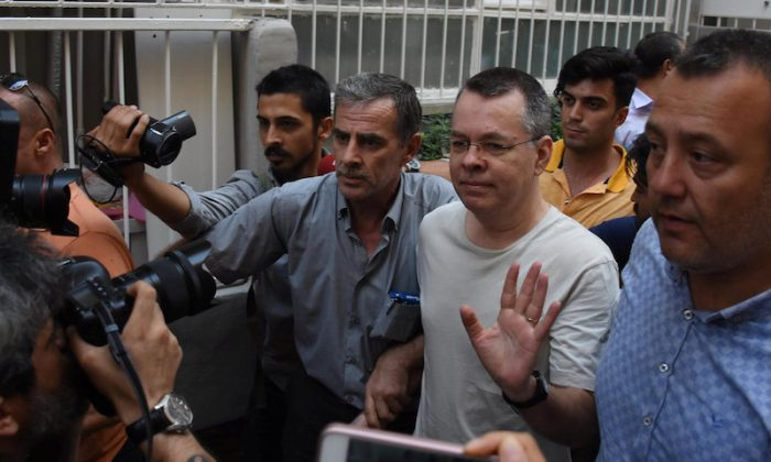 U.S. pastor Andrew Brunson reacts as he arrives at his home after being released from the prison in Izmir, Turkey July 25, 2018. (Demiroren News Agency, DHA via REUTERS)