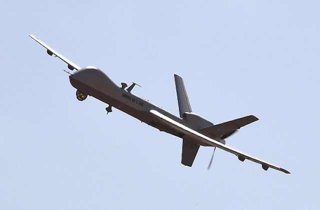 A US made Reaper drone part of Operation Barkhane's aerial detachment flies over the Nigerian military airport Diori Hamani in Niamey on Jan. 2, 2015. (Photo credit should read DOMINIQUE FAGET/AFP/Getty Images)