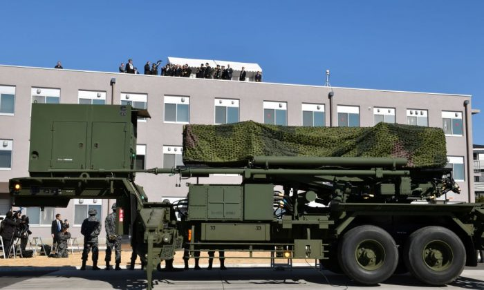 Vice President Mike Pence (top C), accompanied by Japan's Defence Minister Itsunori Onodera, looks out over a PAC-3 surface-to-air missile system during a visit to the Defence Ministry in Tokyo on Feb. 7, 2018. (Kazuhiro Nogi/AFP/Getty Images)