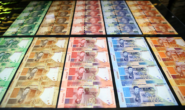 New South African banknotes at the value of ten, twenty, fifty, one hundred and two hundred South African Rand depicting former South African president Nelson Mandela are displayed at the The South African Reserve Bank (SARB) on July 13, 2018 in Pretoria, South Africa. (Photo credit should read PHILL MAGAKOE/AFP/Getty Images)