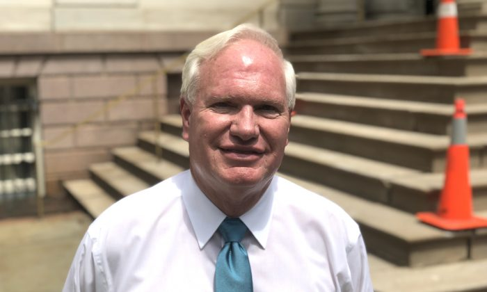 New York State Senator Tony Avella, a democrat, stands near the steps of City hall in New York at a press event on Tuesday, July 31, 2018. (Bowen Xiao/The Epoch Times)