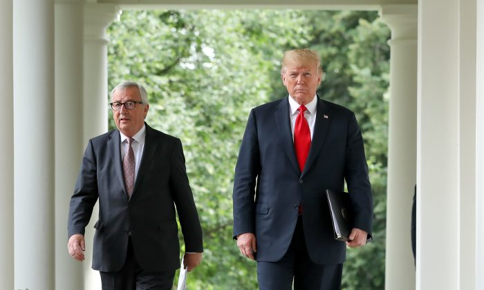 President Donald Trump walks with the President of the European Commission Jean-Claude Juncker to  the Rose Garden of the White House for a joint press conference, in Washington on July 25, 2018. (Samira Bouaou/The Epoch Times)