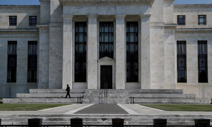 A security guard patrols the Federal Reserve building in Washington, DC, on July 16, 2018. (REUTERS/Leah Millis/File Photo)