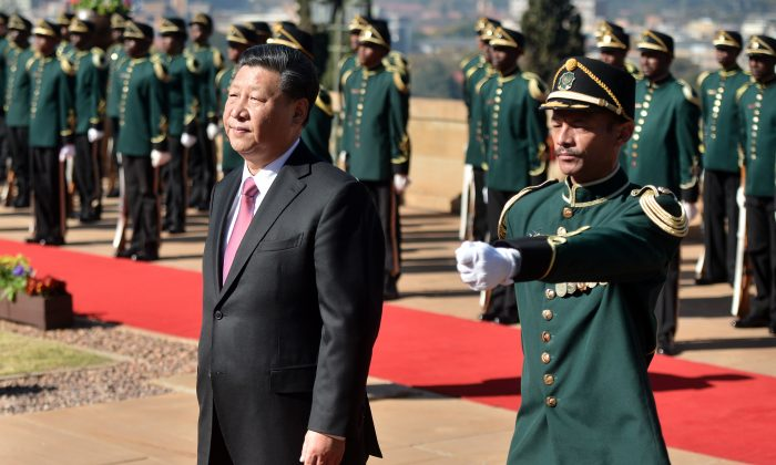 Chinese leader Xi Jinping (L) inspects a military honor guard at the Union Building in Pretoria on July 24, 2018, during his official state visit to South Africa. (PHILL MAGAKOE/AFP/Getty Images)
