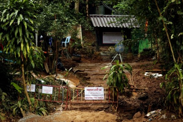 "A ""Restricted Area"" sign is seen in front of the Tham Luang cave complex, after the rescue mission for the 12 boys of the ""Wild Boars"" soccer team and their coach, in the northern province of Chiang Rai, Thailand July 14, 2018."