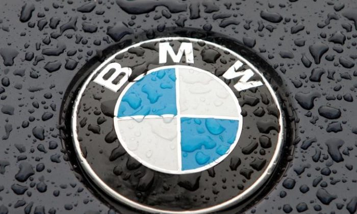The logo of German car manufacturer BMW on the hood of a vehicle in Kiev March 27, 2012. (Reuters/Str)
