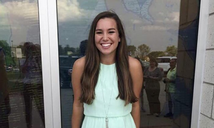 This undated photo released by the Iowa Department of Criminal Investigation shows Mollie Tibbetts, a University of Iowa student who was reported missing from her hometown in the eastern Iowa city of Brooklyn on Thursday, July 19, 2018. A neighbor reported seeing her going for a jog Wednesday evening. The Poweshiek County Sheriff's Office said Monday, July 23, 2018, that Tibbetts had not been found. (Iowa Department of Criminal Investigation/AP)