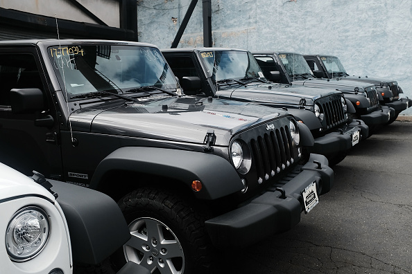 Jeep Wranglers are displayed at a Manhattan Fiat Chrysler dealership on July 23, 2018 in New York City. (Photo by Spencer Platt/Getty Images)