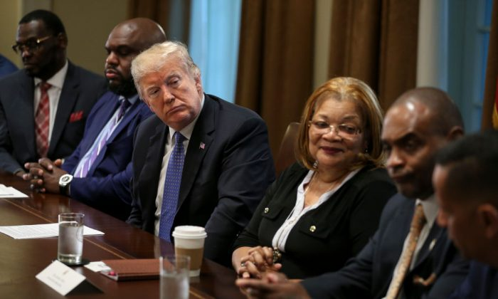 President Donald Trump listens during a meeting with inner-city pastors in the Cabinet Room of the White Housein Washington on Aug. 1, 2018. (Oliver Contreras - Pool/Getty Images)