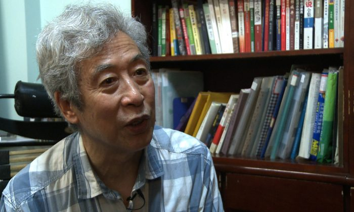 Former professor Sun Wenguang in his home in Jinan City, Shandong Province, on Aug. 28, 2013. (Tania Lee/AFP/Getty Images)