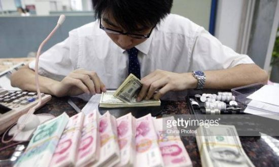 Chinese Get Creative to Send Money Overseas as Yuan Depreciates