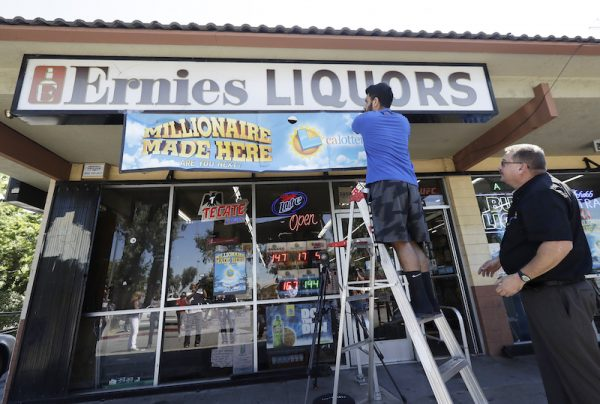The California Lottery says last month's $543 million Mega Millions jackpot was won by 11 members of an office pool that played on a whim. A Lottery statement on Aug. 3, 2018. (AP Photo/Jeff Chiu, File)