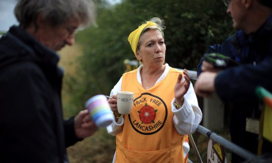 Activist Tina Louise Rothery, of protest group Frack Free Lancashire, waits for the arrival of supporters at an anti-fracking camp near the site of a proposed drilling rig  on Aug. 14, 2014, in Blackpool, England. (Christopher Furlong/Getty Images)