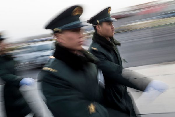 Chinese paramilitary guards walk outside outside the Great Hall of the People on March 5, 2016. (Fred Dufour/AFP/Getty Images)