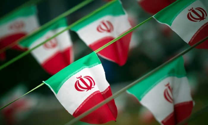 Iran's national flags are seen on a square in Tehran on February 10, 2012.(REUTERS/Morteza Nikoubazl)