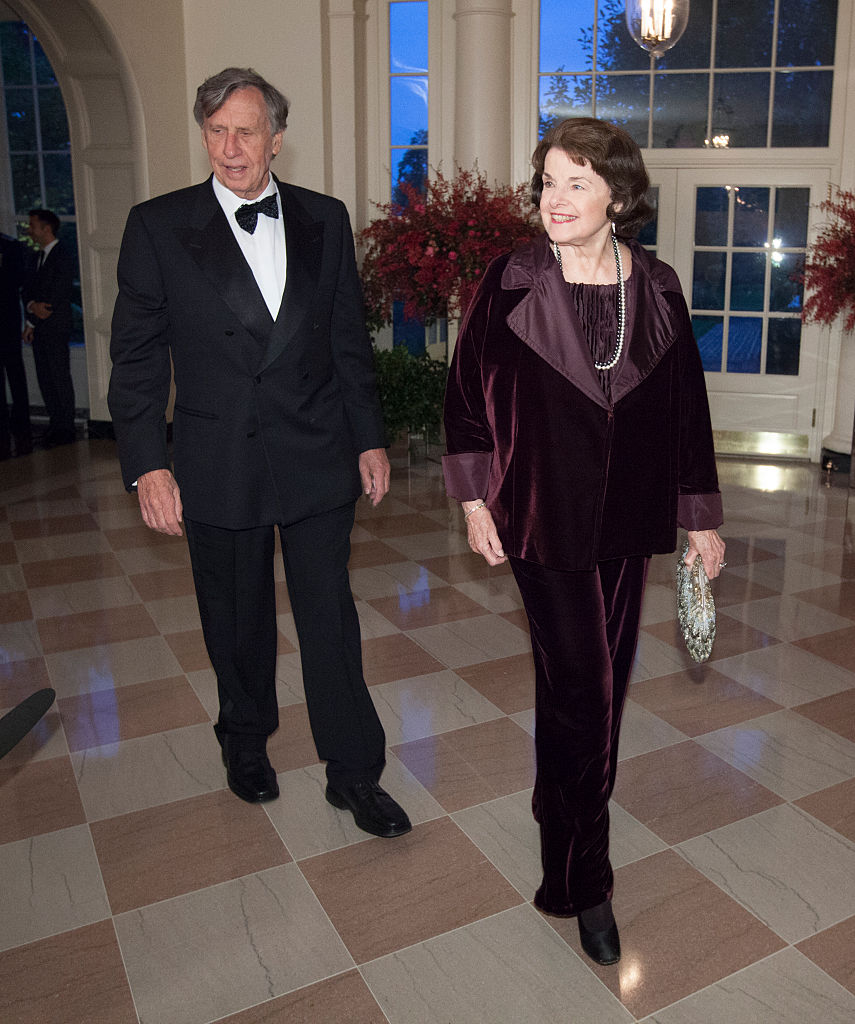 Dianne Feinstein, U.S.Senator and Richard Blum arrive at the State Dinner for China's President Xi and Madame Peng Liyuan at the White House for an official State Visit in Washington on Sept. 25, 2015. (Photo by Chris Kleponis-Pool/Getty Images)