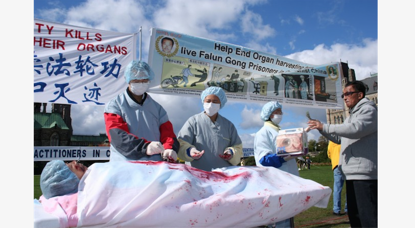 A re-enactment of organ harvesting in China on Falun Gong practitioners, during a rally in Ottawa, Canada, 2008. (The Epoch Times)