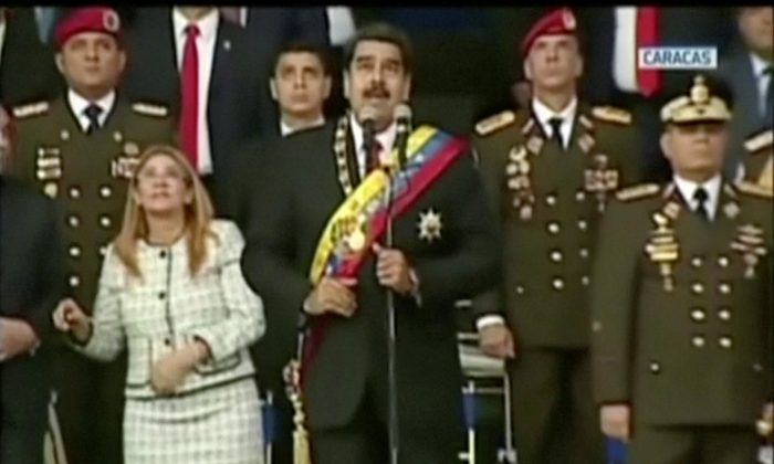 Venezuelan President Nicolas Maduro reacts during an event which was interrupted in Caracas, Venezuela on Aug. 4, 2018. (VENEZUELAN GOVERNMENT TV/Handout via REUTERS TV.  )