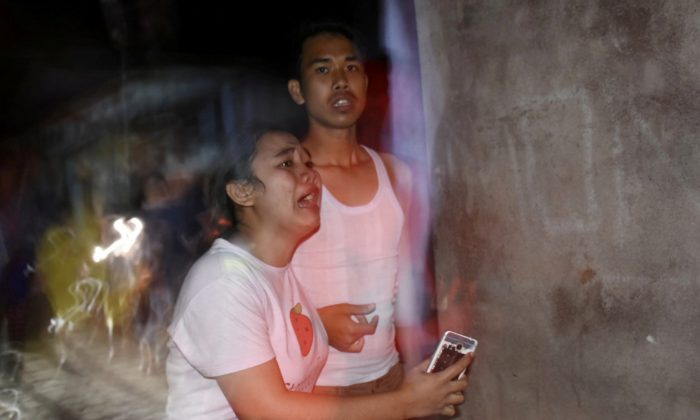 People react following an earthquake in Ampenan district, Mataram, Lombok, Indonesia Aug. 5, 2018,  in this photo taken by Antara Foto. (Antara Foto/Ahmad Subaidi/ via Reuters)