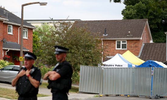 Police officers stand on duty outside Sergei Skripal's home in Salisbury, Britain, July 19, 2018. (Reuters/Hannah McKay)