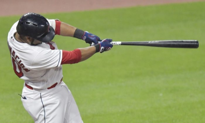 Aug 6, 2018; Cleveland, OH; Cleveland Indians designated hitter Edwin Encarnacion (10) hits a three-run home run in the seventh inning. (David Richard-USA TODAY Sports)