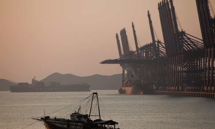 A cargo ship navigates its way into Shenzhen Port in Shenzhen City, Guangdong Province, on Nov. 28, 2010. (Daniel Berehulak/Getty Images)