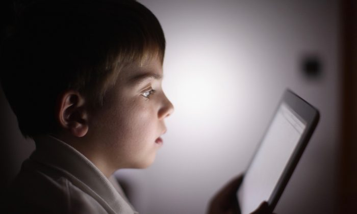 A 10-year-old boy uses an Apple iPad tablet computer on Nov. 29, 2011, in Knutsford, United Kingdom. (Christopher Furlong/Getty Images)