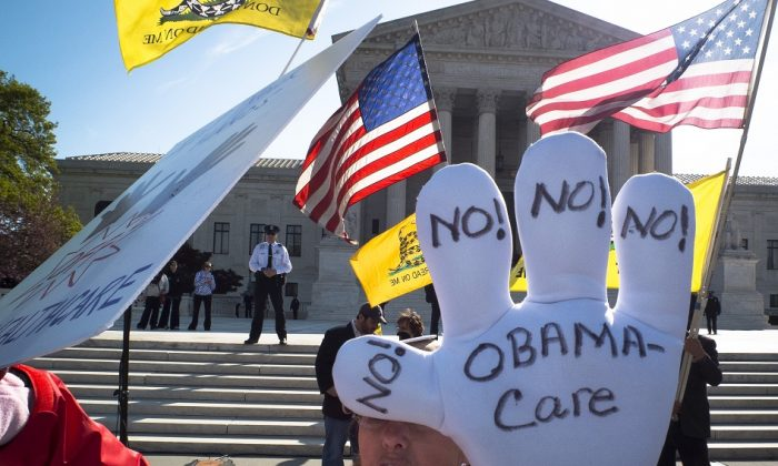 An individual protests the Affordable Care Act, also known as Obamacare, outside the U.S. Supreme Court on March 28, 2012 in Washington, DC. (MLADEN ANTONOV/AFP/Getty Images)